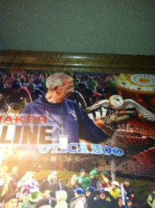 Grandpa showing off the Utica Zoo on the wall at Applebees!