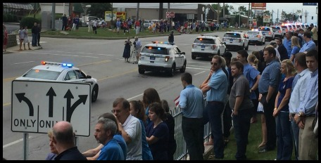 Officer Sonny Kim's funeral procession stretched for 14 miles along Montgomery Road in Cincinnati. DearKidLoveMom.com