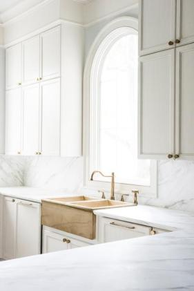 stacked-kitchen-cabinets-brass-dual-apron-sink