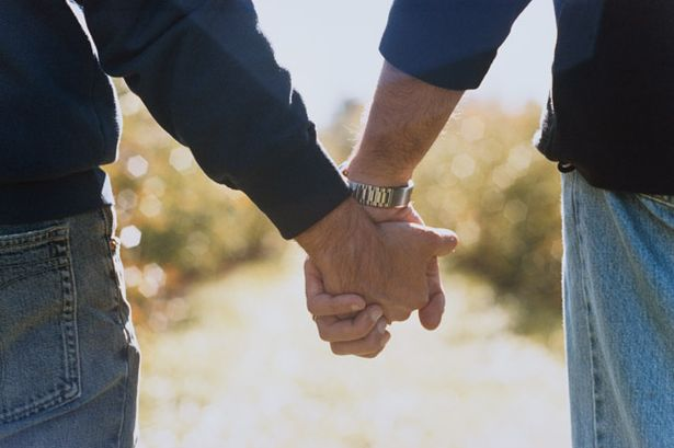 two-men-holding-hands