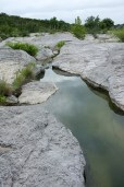 The rocky ledges are exposed when the water is low