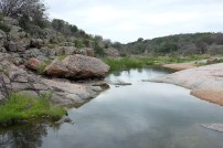 Meandering stream that runs into Inks Lake