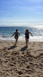 My best friend and I running for the ocean. I had never been to the beach before, so this was pretty exciting.