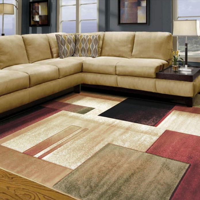 decoration-salon-canapé-beige-coussins-tapis-motifs-géométriques