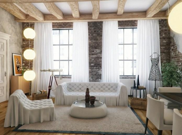 decoration-salon-canapé-chesterfiel-capitonné-blanc-mur-brique-poutres