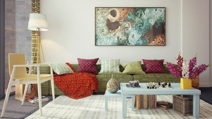 decoration-salon-canapé-vert-rembourré-coussins-décoratifs-tableau-art-fleurs-fraîches décoration de salon