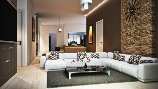 decoration-salon-coussins-décoratifs-mur-accent-pierre-parement-peinture-murale-marron décoration de salon