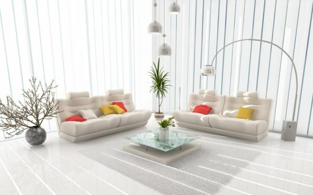 decoration-salon-coussins-jaune-orange-luminaire-méal-plantes-vertes-table-basse-verre-blanc décoration de salon