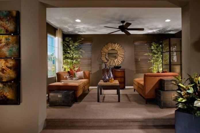 decoration-salon-plantes-vertes-bambou-canapés-marron-miroir-soleil