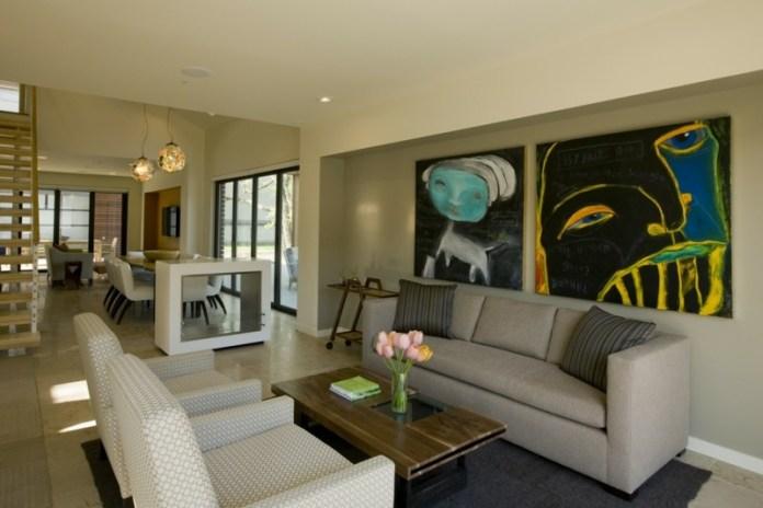 decoration-salon-tableau-art-abstrait-canapé-gris-fauteuils-blancs-motifs-cercles