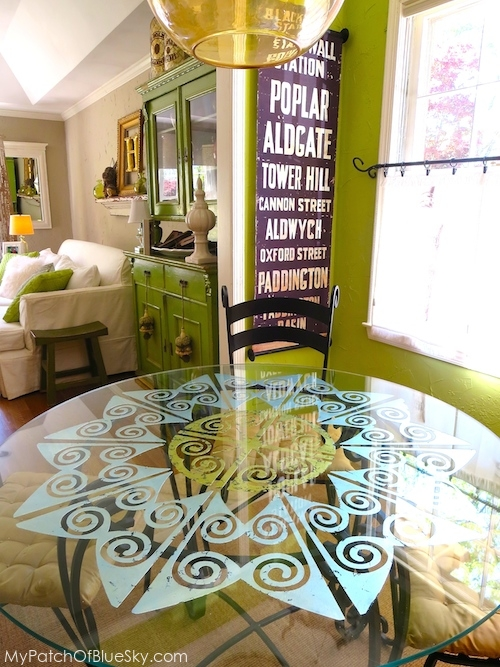 Photo of stenciled, gilded glass tabletop