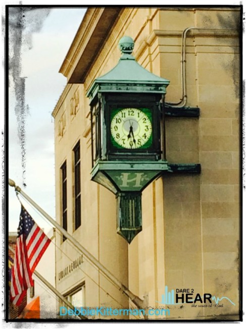 clock and flag with logo