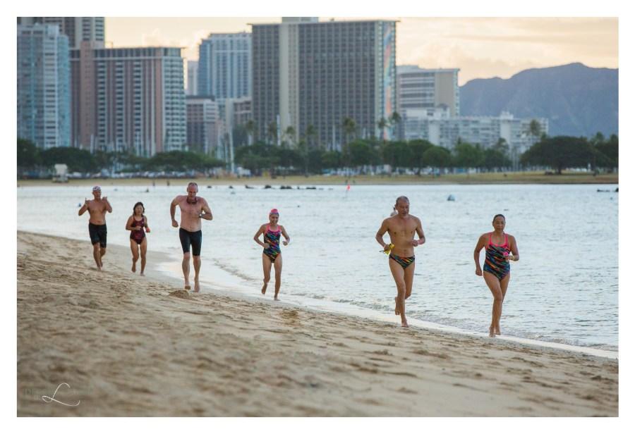 people jogging along ala moana beach