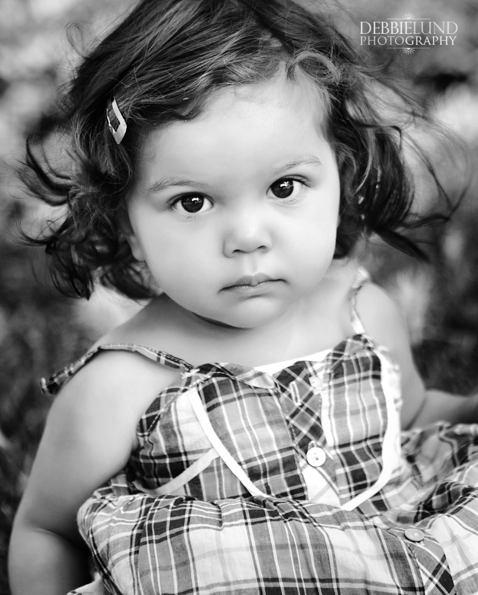 black and white outdoors photograph of a little girl