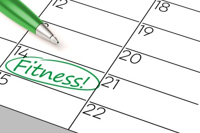 Green pen marking fitness appointment in calendar (3D Rendering)