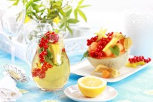Delicious fresh fruits served in melon bowl as dessert with lemo