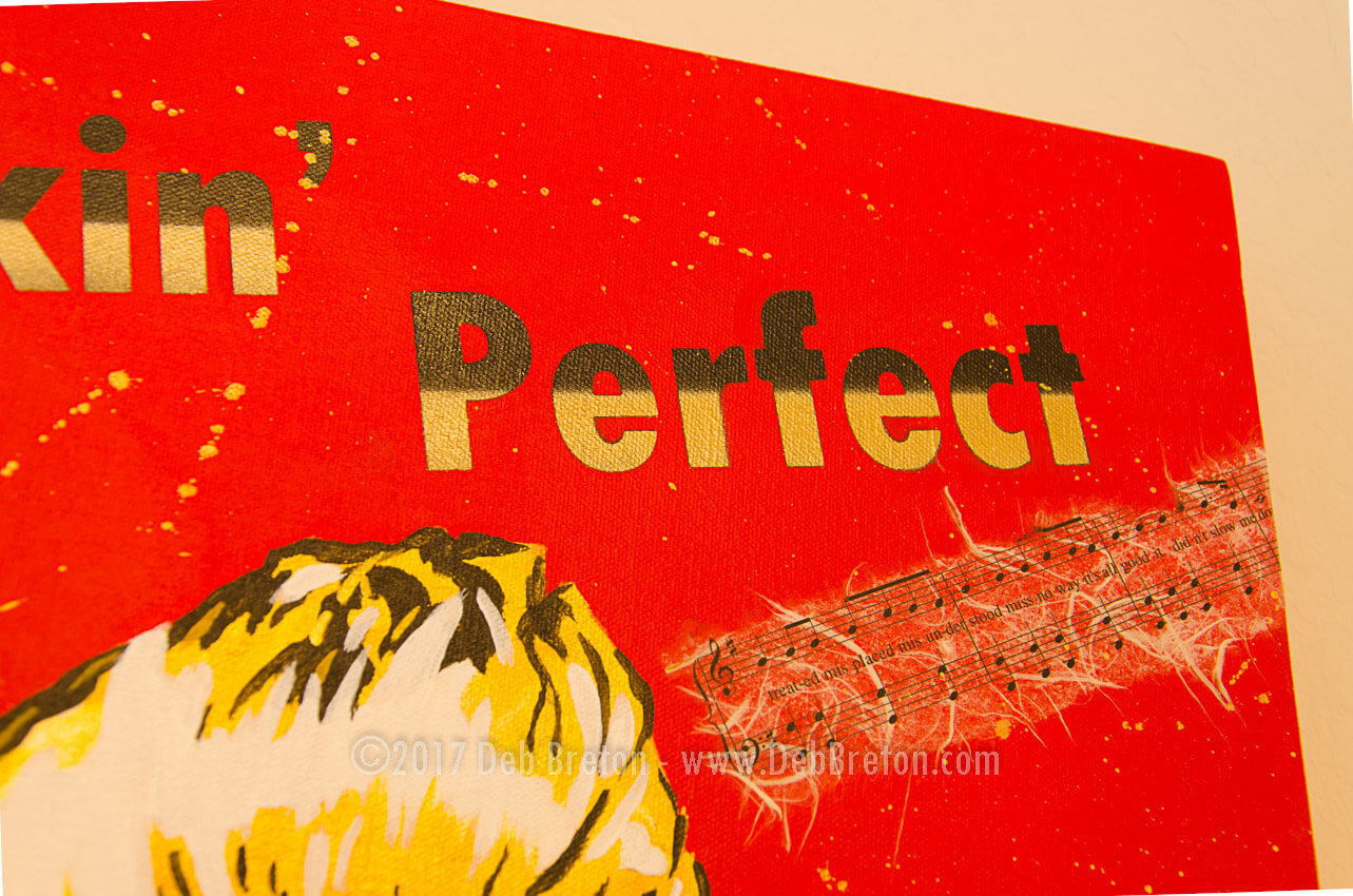 Close-up of F**kin' Perfect text with black & gold lettering
