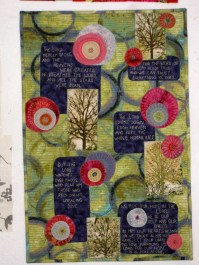 """Hope in Uncertain Times, 18 1/2X28"""", Machine appliquéd and quilted. Extensive hand embroidery. $500 Description: This quilt, and especially these words, were a direct response to the horrific events that happened at the Sandy Hook elementary school, which was followed closely by the Boston Marathon bombings and the explosions in Texas. I have friends in all those areas. I am a blogger, and everywhere I read, I could see the uncertainty that was expressed in the face of such events. I found these verses in the Psalms, and they brought me great hope. Through this quilt I have been able to share that same hope with many people."""