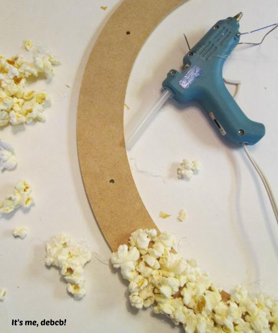 Gluing popcorn on wreath