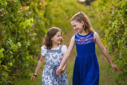 sisters walking in vineyards