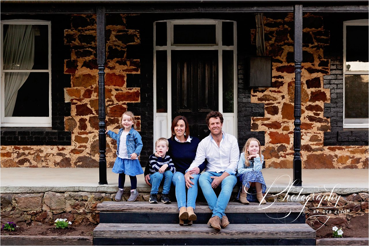 family+sitting+on+verandah+kanagarilla
