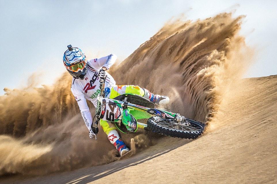 Motocross rider surfing dunes in Villa Gesell, Argentina.