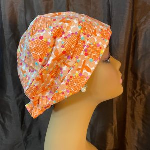 orange flowers and colorful dots scrub hat