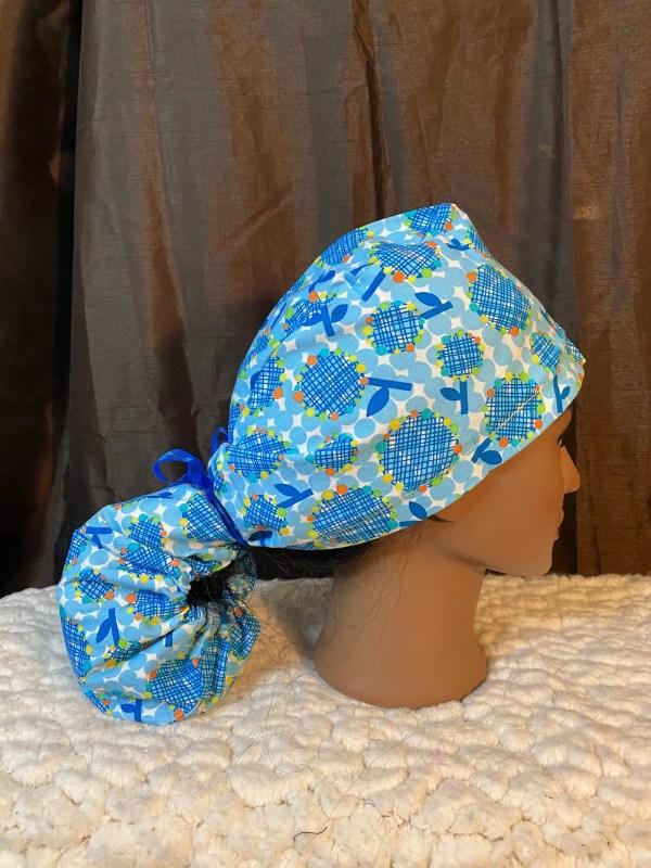 blue ponytail scrub hat