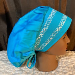 Blue bouffant scrub hat with white embroidery