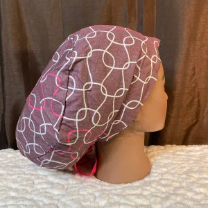 Brown scrubhat with pink and white swirls