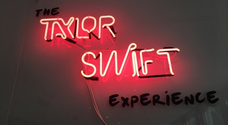 """The Taylor Swift Experience welcomes guests with neon lights typical of the style of the singer's latest album, """"1989."""""""