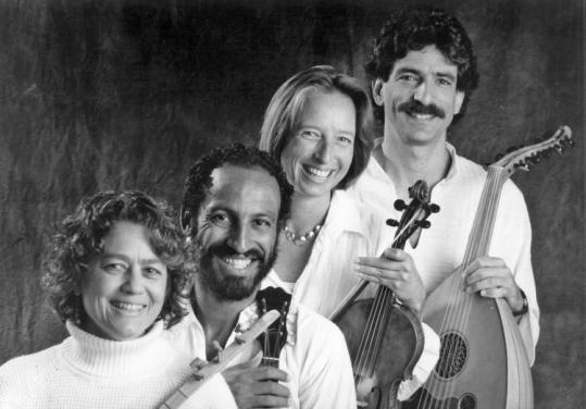 Black and white photo of Voice of the Turtle's four members holding instruments