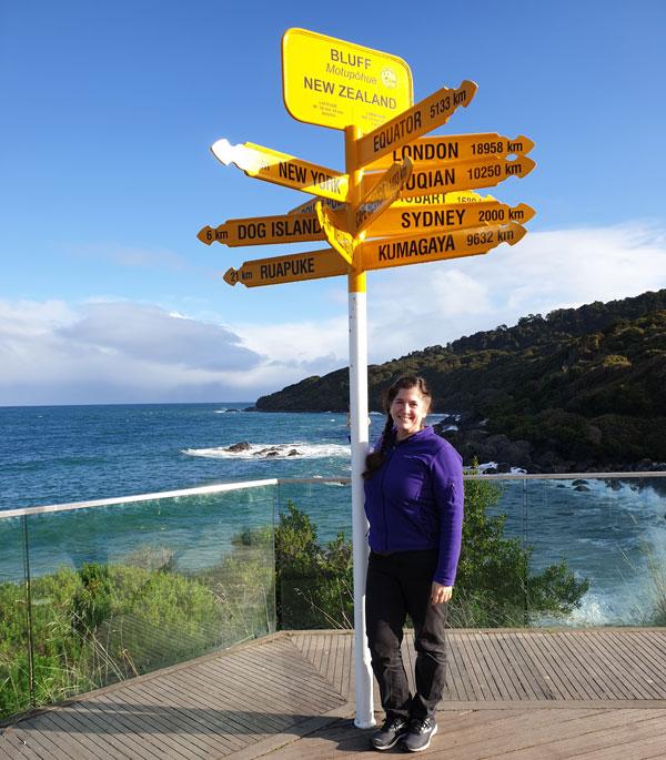 New Zealand signpost with Deborah Munro