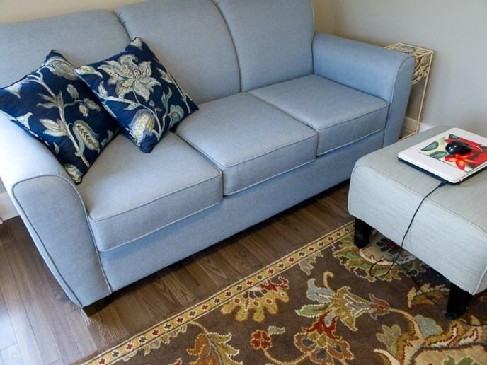 sky blue sofa - fabrics and rugs working together