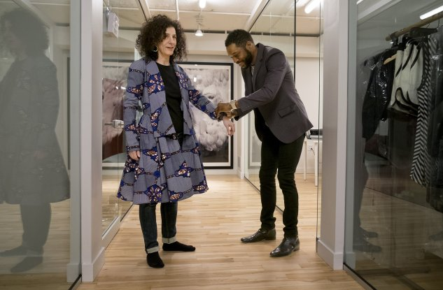 Fashion designer Reuben Reuel Riddick (right), of Demestik by Reuben Reuel, adjusts the fit of a garment being tried on by customer Debbie Chase at the St. Louis Fashion Incubator in downtown St. Louis Friday, March 17, 2017. Riddick relocated his company from Brooklyn to St. Louis after being selected for the incubator's Inaugural Designer Class. Photo by Sid Hastings