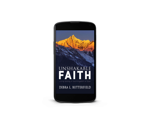 Unshakable eBook displayed on cell phone.