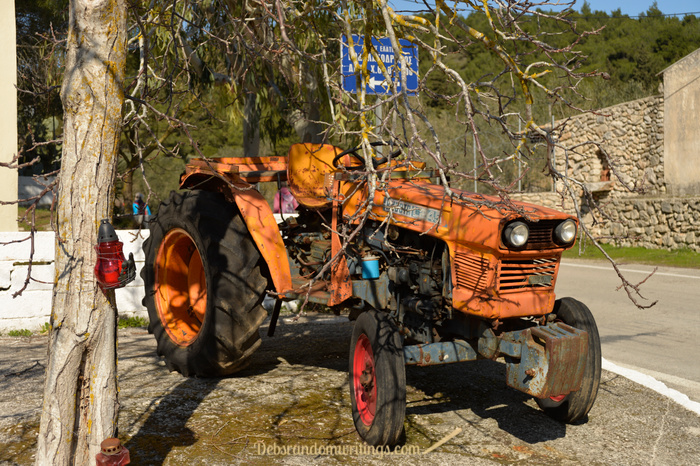 A cute looking orange tractor