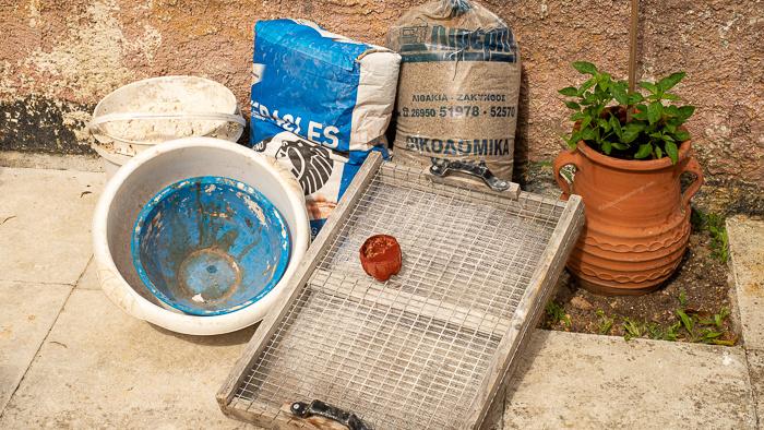Cement, marble dust, large sieve, plastic bowls to make a concrete flower pot
