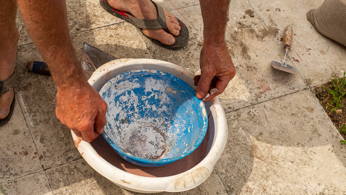 A smaller bowl is placed inside a larger bowl to finish the mould for a concrete pot.