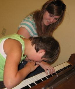 Playing the piano with Ms. Kelsey