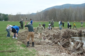 A dozen or so people working on a streambank restoration. Vermont Watershed Grants