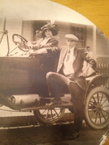 A dashing couple pose with their Ford Model T.
