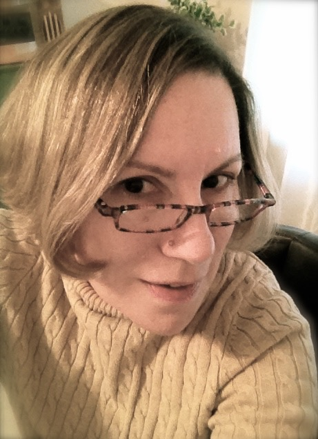 A portrait of a woman wearing glasses.