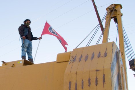 A water protector atop excavation equipment in Presidio County, Texas, last weekend.