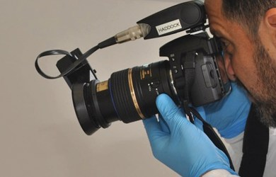 Dentist conducting dental photography
