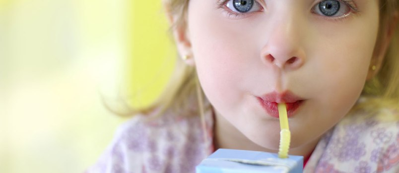 Child with sugary drink