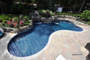 Travertine Surrounding A Free Form Pool Manorhaven Ny