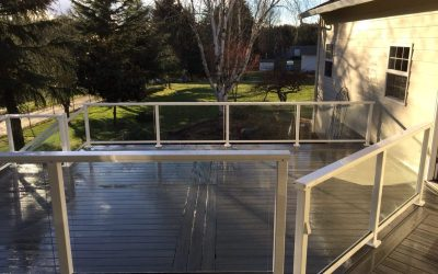 Composite deck with glass railing