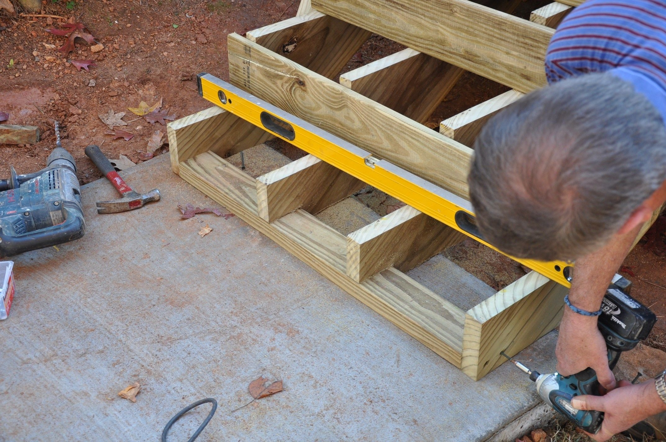 How To Anchor Deck Stairs To Concrete Decks Com | Attaching Wood To Concrete Steps | Composite Decking | Handrail | Staircase | Screws | Deck Stairs