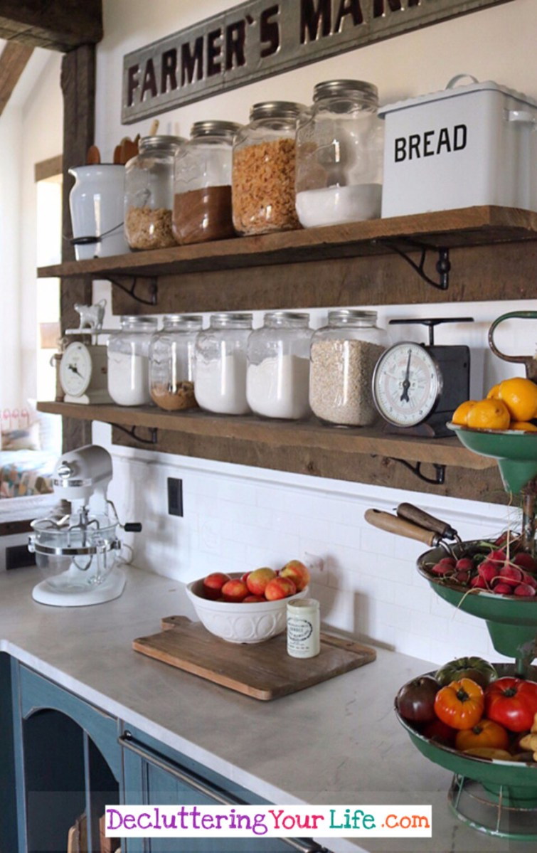 Gorgeous rustic kitchen DIY idea to organize and declutter in your kitchen.  This DIY kitchen shelves idea is beautiful - and would be great in a small kitchen with limited wall space.